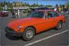 MGB-GT (NoJuan) Tags: red voigtlander mg a7 sportscar mgb redcar ultron mgbgt vintagesportscar fotodiox redsportscar shorelinewa fotodioxadapter sonya7 carscoffeeseattle coffeeandcarsseattle