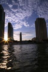 Sunset in the city (Kaniz Khan 2009) Tags: city sunset sky sun building river thailand bangkok bluesky kanizkhan