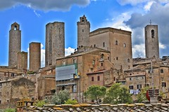 San Gimignano's Medieval Towers. (Emanuele Barcali) Tags: vacation sky italy sun black green tower love clouds countryside photo san artist view gimignano weekend withe sunny medieval hills tuscany sangimignano castello borgo castel torri blackwithe togheter