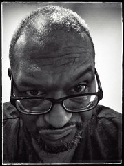 2015.05.01  Day 101 (HTRM2) Tags: blackandwhite bw selfportrait man black male texture apple self beard glasses grunge monochromatic angry scowl africanamerican aged grayscale frown middle j2 annoyed irritated 40s greyscale resigned iphone plucked 2015 365days htrmiller2 snapseed iphone5s