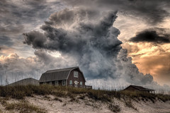 There's a Storm a Brewin' (NYRBlue94) Tags: ocean light sea sky cloud sun seascape storm reflection beach water weather clouds landscape coast nc sand waterfront outdoor north stormy calm atlantic shore carolina thunderstorm rays seashore topsail hdr severe