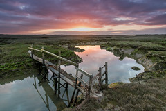 The Bridge (merseamillsy) Tags: wood morning bridge reflection water clouds rural creek sunrise reflections river landscape coast early wooden coastal coastline marsh essex woodenbridge cloudscape saltmarsh marshy rickety