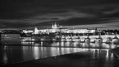 The Fairytale of Prague (McQuaide Photography) Tags: old city longexposure nightphotography travel light blackandwhite bw reflection building castle history tourism water monochrome skyline architecture night zeiss river outside mono blackwhite europe cityscape waterfront prague outdoor sony tripod gothic praha landmark praskhrad historic czechrepublic fullframe alpha charlesbridge vltava oldbuilding waterside touristattraction praag lessertown manfrotto c1 praguecastle gothicarchitecture czechia centraleurope karlvmost malstrana capitalcity eskrepublika variotessar captureone sonyzeiss mcquaidephotography a7rii ilce7rm2 captureonepro9 mirrorless1635mm