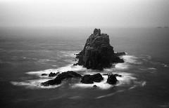 La fine del Mondo (Lo Zatto) Tags: sea bw mist seascape film fog 50mm landscapes rocks cornwall waves nikonf100 landsend nikkor50mmf14afd