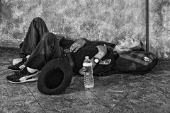 Empty hat (FotoGrazio) Tags: poverty sleeping people blackandwhite art texture water hat composition contrast photography photoshoot lasvegas sleep nevada homeless poor streetphotography highcontrast streetscene bottledwater napping resting moment photographicart capture digitalphotography sandiegophotographer artofphotography flickrelite californiaphotographer internationalphotographers worldphotographer photographersinsandiego fotograzio photographersincalifornia emptyhat waynegrazio waynesgrazio