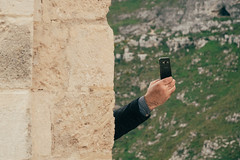 Selfie Round the Corner (toletoletole (www.levold.de/photosphere)) Tags: street italy wall fuji hand arm matera selbstportrait mauer selfie fujixpro2