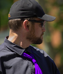 Focused Attention (swong95765) Tags: man guy hat sunglasses beard purple bokeh tie shades cap focused