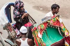 H504_3495 (bandashing) Tags: rickshaw girl passengers ride floral headscarf print mobile phone talk hijab street sylhet manchester england bangladesh bandashing aoa socialdocumentary akhtarowaisahmed