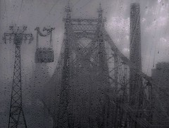 """Raindrop On Roosevelt Island Tram Window During Summer Downpour (In View Is Cable Car Passing As We Pass Along Edward R Koch Queensboro Bridge) (nrhodesphotos(the_eye_of_the_moment)) Tags: dsc03393160 """"theeyeofthemoment21gmailcom"""" """"wwwflickrcomphotostheeyeofthemoment"""" rooseveltislandtram rainstorm window raindrops bridge tram cablecar weather summertimerainstorm nyc monochrome sky clouds infrastructure architecture smokestack summertime season urban manhattan metal glass"""