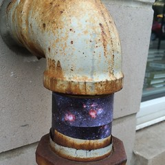 M74 Spiral Galaxy wrapped around water pipe outside The Book Cellar bookstore (spudart) Tags: urban streetart chicago art love germantown wow wrapping stars fun found happy idea amazing cool artwork sweet good great pipe thoughtful wrap super bookstore nasa publicart neat foundart magical waterpipe lincolnsquare printout wrappingpaper lincolnavenue 60625 bookcellar wrappedart starstrips placedart spacewraps alittlebitofchristo