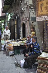 Al-Madina Souk An Afternoon in Aleppo, The Ancient City that Was October 31 2010 Syria Middle East (eriagn) Tags: travel art history tourism wool rock fruit architecture concrete religious photography wooden traffic citadel minaret traditional prayer religion middleeast streetphotography documentary mosque tourist tourists unescoworldheritagesite traveller textures syria souk historical produce bazaar dailylife textiles fortification moat fortress weaving income citizens aleppo hawkers syrian bathhouse suq shopkeeper marked beliefs ngaire ancientcity umayyadmosque orientalrugs camelhair medievalbuilding ceilingdecoration oldwalledcity citadelofaleppo traditionaltextiles eriagn ngairehart almadinasouq syrianstreetfood mpsqueinterior syrianpostbox