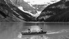 Gone Paddlin' (chrisroach) Tags: blackandwhite bw mountain canada monochrome rockies blackwhite still paddle canoe glacier alberta lakelouise paddling lightroom canadianrockies paddlin
