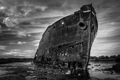 Stranded (*ScottyO*) Tags: sky blackandwhite bw history water rotting clouds boat rust iron ship outdoor decay australia mangrove bow swamp adelaide historical hull hulk southaustralia steamer excelsior portadelaide muttoncove