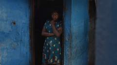 Woman in Munnar (Rick Elkins) Tags: blue woman india building home girl standing outside village looking kerala doorway munnar