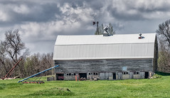 Can't Fit In (henryhintermeister) Tags: summer minnesota clouds rural outdoors farming barns oldbarns nostalgia farms pastoral countryliving worthington