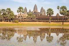The Angkor Wat and Reflection. (baddoguy) Tags: blue sky reflection tree horizontal architecture outdoors photography pond ancient cambodia religion tranquility nopeople angkorwat unescoworldheritagesite palmtree copyspace siemreap angkor hinduism ancientcivilization traveldestinations colorimage famousplace ruralscene siemreapprovince stonematerial cambodianculture