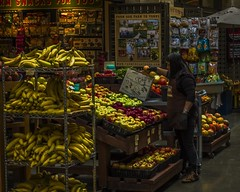 Fruit Stand SF-1 (Patrick Gregerson) Tags: dark fruit candid 2015 california november sf sanfrancisco fall family fun northerncalifornia outside inside shops fruitstand colors yellow red bananas apples ferrybuilding theembarcadero foodmarket