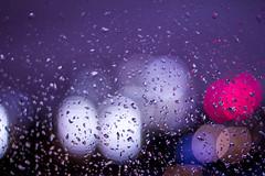 under the purple rain... (Nassia Kapa) Tags: london window water rain night lights blog drops purple bokeh romance thoughts citylights romantic stories purplerain nassiakapa