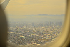 Escape from L.A. (radargeek) Tags: california ca sky clouds airplane flying losangeles downtown windowseat