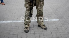 062923328-armed-soldier-exhibition (daria.boteva) Tags: city people army war uniform gun fighter force military helmet band police environmental ukraine illustrative equipment human national camouflage badge terrorists soldiers form aggression guards combat patriotism anti ukrainian armored balaklava balaclava defense troops annexation weapons ato armed heraldic automaticweapon