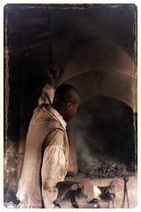 The fire keeper (Irina1010) Tags: man shop canon fire smoke plantation lowkey middletonplace ironworker claireobscure firekeeper ironshop outstandingromanianphotographers aviaryedit