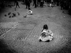 My birds (malteborggrewe) Tags: street bw bird netherlands monochrome amsterdam children feeding olympus cobblestone omd