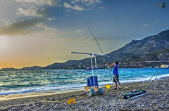 Fishing competition. Loutraki 14.05.2016 (theseustroizinian) Tags: blue sunset sea seascape beach beauty greek seaside fishing fisherman hellas greece hdr hellenic goldenhours seasunandclouds simplysuperb hdraward