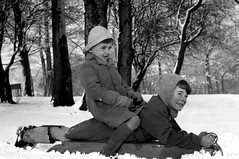Padded Ride (theirhistory) Tags: winter snow boys children coats hat balaclava park wellies cloves shorts rubberboots trees cold souwester