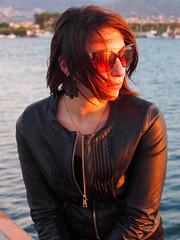 Admiring the sunset... (Lucio Busa) Tags: sunset sea portrait italy sunlight portraits sunrise girlfriend harbour olympus mm ritratti ritratto zuiko omd 1250 em5