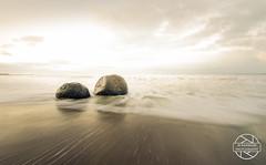 Dragon eggs (jbrambaud) Tags: longexposure light sunset sea newzealand clouds pacific boulders moeraki