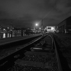 Harbourside by Night (Ged Slaughter Photography) Tags: harbourside bristol mshed bee crane tracks rail railway dockyard docks gedslaughter bw night receding lines