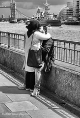 He's Got That Lovin' Feeling (Steve Burtrand LRPS) Tags: streetphotography london bw riverthames people love