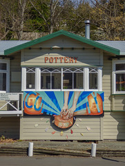 The Pottery Community (Steve Taylor (Photography)) Tags: pottery community nelson art sign building window weatherboard green brown blue orange fun wooden newzealand nz southisland trees splatter wheel throwing pot clay kiln