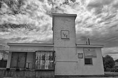 Ice is  Nice (slammerking) Tags: ice clouds plant abandoned brick budweiser loadingdock blackwhite bw