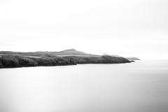 Welsh Coastline, Pembrokeshire (Geraint Rowland Photography) Tags: longexposure sea blackandwhite water beauty wales rocks europe unitedkingdom peaceful cliffs minimalism amomentintime welshcoastline rockyoutcrops welshlandscapes walesphotography beautifulblackandwhite minimalistphotographyinuk