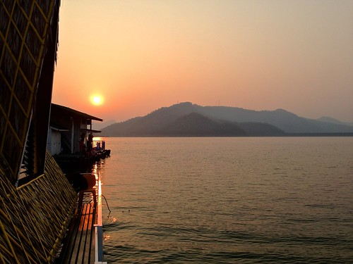 Sunrise on Srinakarin Lake seen from a houseboat in Kanchanaburi province, Thailand