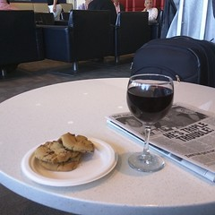 Hanging out with wine and cookies at the Delta Sky Lounge while I wait for my flight.