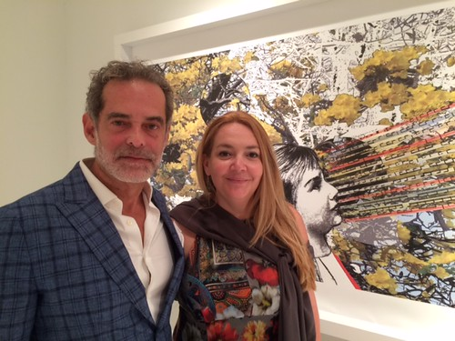 Miguel Fernandez, owner of TUB Gallery and MADA VP, with Artist Sandra Ramos at her opening at the gallery in Wynwood