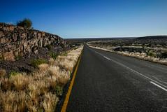Beautiful road (Marc Heurtaut) Tags: africa composition dark landscape lumix rocks wideangle bluesky na panasonic curve asphalt namibia karas yellowline namibie lx100 dryherbs