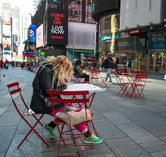 Texting (UrbanphotoZ) Tags: plaza nyc newyorkcity red woman ny newyork yellow colorful sitting turquoise 7 highlights midtown timessquare blonde pedestrians westside nasdaq fuscia texting revlon foldingchairs nasdaqmarketsite livenow loveison