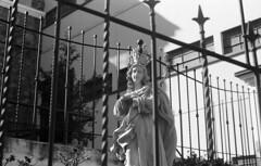 Prisionera (Jrletranc) Tags: sculpture bars escultura virgenmara baranda fujineopanacros100