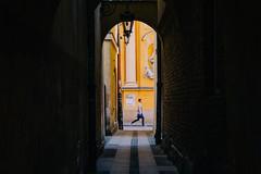 """I'm Late!"" (freyavev) Tags: street old church yellow person town arch outdoor space streetphotography poland polska negative polen warsaw passage warschau poljska varsava"