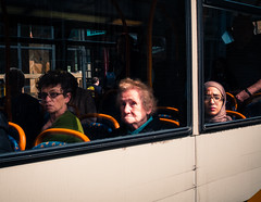 Three on the bus (Tucka Does Street) Tags: street old city cambridge urban dog color colour bus male smile hat cane female standing hair bag walking point photography reading glasses couple shoot sitting phone purple shot sony coat transport young streetphotography sigma olympus shades single thinking laugh doggy 60mm ping f28 cambridgeshire omd 19mm em10 nex5 sigma19mm28 olympusomdem10
