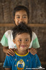 children - brother & sister - family 1 - Kudat, Sabah, Malaysia (Christian Loader Photography) Tags: family boy portrait people beach girl smile face smiling children eyes asia southeastasia child head traditional culture malaysia borneo tropical local longhouse sabah cultural kudat rungus scubazoo christianloader scubazooimages