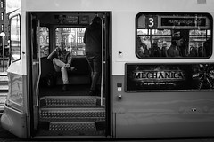 Tram caller (elgtexps) Tags: people monochrome gteborg blackwhite sweden gothenburg streetphotography tram sverige tramstop jrntorget gatufoto fujifilmx100t