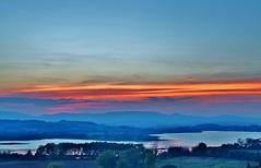 Umbrian sunset over Lake Chiusi (Italy) (stevelamb007) Tags: sunset italy mountains reflection clouds rural nikon hills umbria chiusi 18200mm d90 stevelamb villastrada lakechiusi lagochiusi