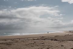 lonely man and the ocean, Barreta Island / Santa Maria Cape Island, PT (Aleksandra S.K.) Tags: ocean blue cloud portugal water faro sand riaformosa