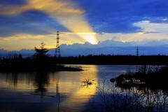 Light up the sky (Alothan) Tags: blue light sunset orange sun lake ontario canada reflection water clouds island dusk superior reflect rays thunderbay