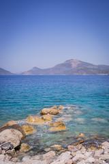 Rocks sea view (aleksey_kondratiev) Tags: turkey fethiye oludeniz mediterranean sea water blue wave waves seashore rocks sky mountain