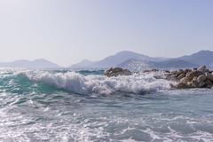 Wave (aleksey_kondratiev) Tags: turkey fethiye oludeniz mediterranean sea water blue wave waves seashore rocks sky mountain
